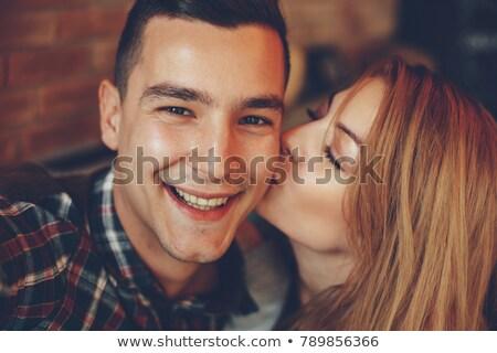 Barátnő csók fiúbarát étterem közelkép mosolyog Stock fotó © Kzenon