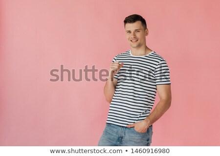 Vrolijk man gestreept tshirt tonen duim Stockfoto © deandrobot