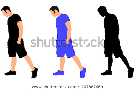 side view of man with hands in pockets looking down Stock photo © feedough