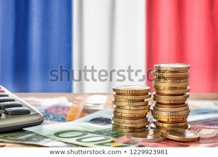 Euro banknotes and coins in front of the national flag of France Stock photo © Zerbor