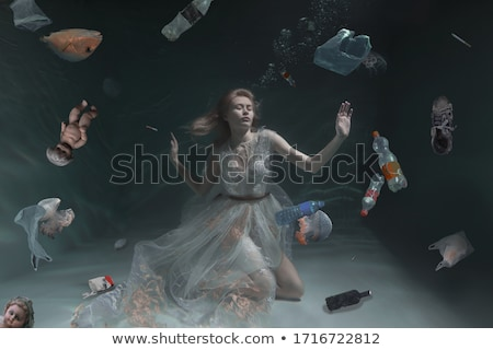 swimmer at sea. ocean pollution. ecology and plastic waste Stock photo © studiostoks