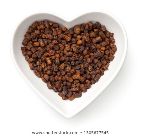 bee pollen propolis in heart bowl isolated stock photo © threeart