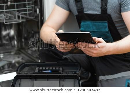 техник посудомоечная машина мужчины цифровой работу домой Сток-фото © AndreyPopov