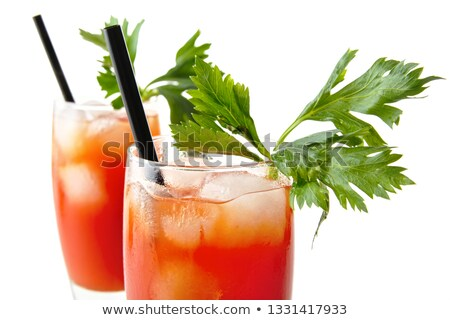 close up bloody mary with ice cubes with celery on white from above stock photo © dla4