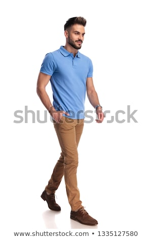 Young  casually-dressed man wearing a light blue polo looking at Stock photo © feedough