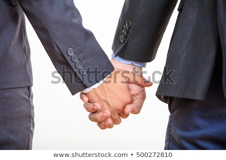 Young homosexuals gay couple love each other on a white background. Stock photo © Lopolo