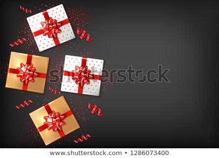 Ajándékdobozok piros íj vektor valósághű sötét Stock fotó © frimufilms