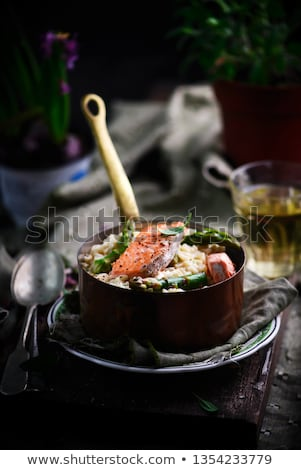 Stock photo: Risotto with asparagus and salmon ..style rustic.