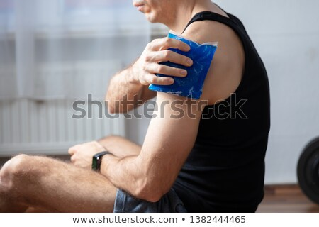 Man Applying Cool Gel Pack On His Shoulder Stock photo © AndreyPopov