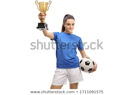Happy sporty young woman holding gold trophy cup Stock photo © boggy
