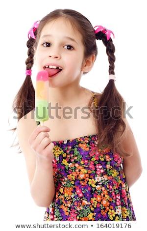 Little girl gosto doce vara bebê laranja Foto stock © ElenaBatkova