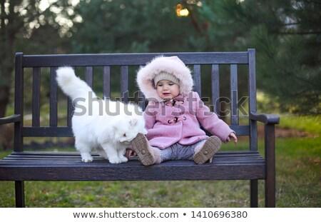 Little cute baby girl wearing autumn outfit and white cat sittin Stock photo © dashapetrenko