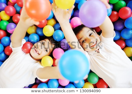 happy family with little kids having fun together in the pool stock photo © dashapetrenko