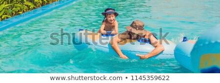 Baba oğul eğlence su parkı afiş uzun format Stok fotoğraf © galitskaya