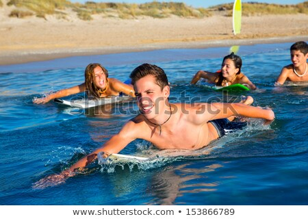 Man and Woman Swimming on Surfboards in Blue Sea Stock photo © robuart