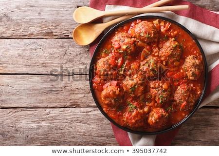 rustic italian meatballs in tomato sauce Stock photo © zkruger