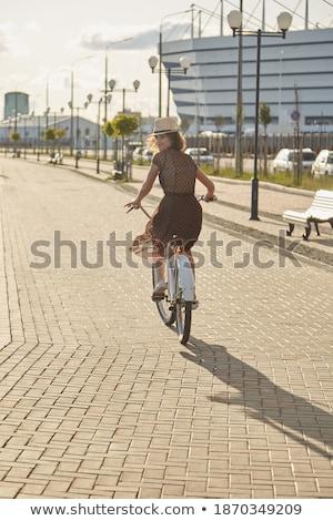 Hátulnézet kép fiatal hölgy bicikli utca Stock fotó © deandrobot