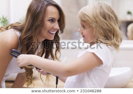 Mother Straightening Hair With Straightener Stock photo © AndreyPopov