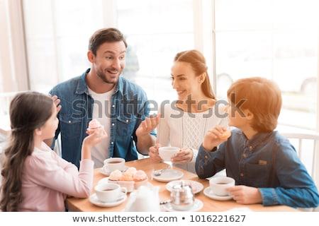 Család kávéház kávézó iszik tea asztal Stock fotó © robuart