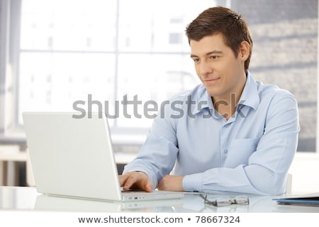 Goodlooking businessman with laptop Stock photo © nyul