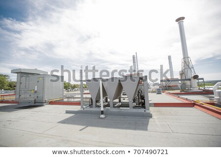 Air vents on the roof of building in functional and operational condition. Stock photo © Lopolo