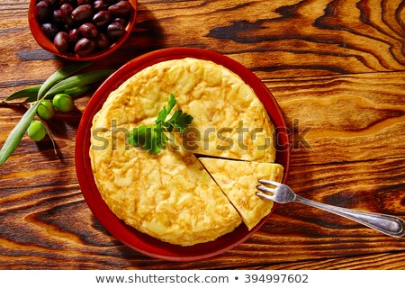 Tortilla espanol primer plano caucásico hombre cocina Foto stock © nito