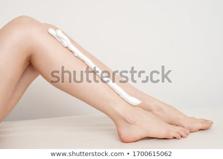Long Woman Legs isolated on white. Depilation. Legs Smooth Skin, Female Beauty Care and Hair Removal Stock photo © serdechny