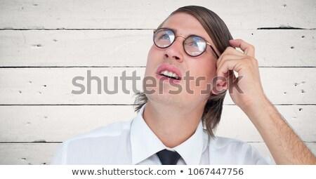 Close up of nerd man scratching head against white wood panel Stock photo © wavebreak_media