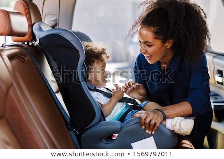 Mother boy car seat Stock photo © Lopolo