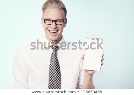 Işadamı notepad mutlu genç Stok fotoğraf © lichtmeister