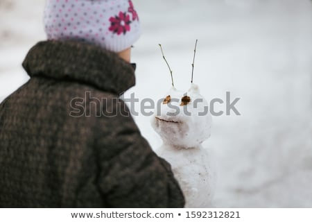 Family Sculpting Snowman Outdoors Wintertime Fun Stock photo © robuart