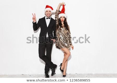 Joven sombrero aislado blanco feliz modelo Foto stock © Elnur