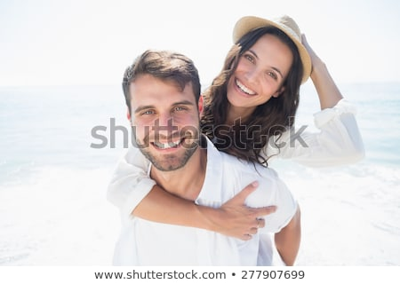Outdoor portrait of beautiful smiling woman, handsome man and th Stock photo © vkstudio