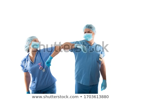nurses in scrubs elbow bump instead of shaking hands during COVI Stock photo © lovleah