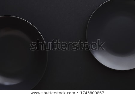 Empty plates on black background, premium dishware for holiday dinner, minimalistic design and diet Stock photo © Anneleven