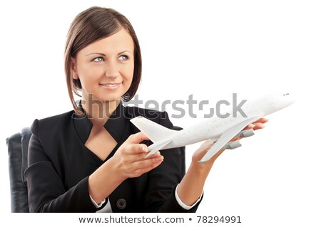portrait of young happy woman stewardess holding jet aircraft in stock photo © hasloo