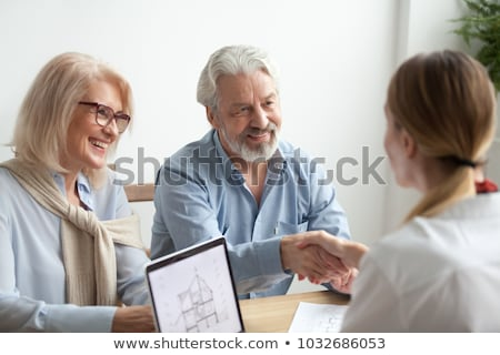 Older couple working in an office Stock photo © photography33