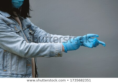 woman putting her arm on a wall Stock photo © photography33