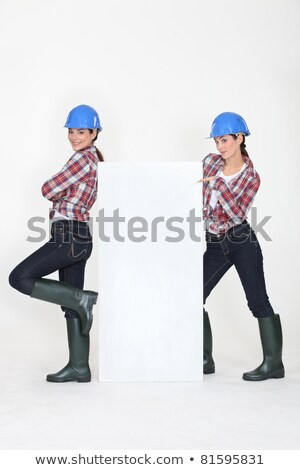 duo of young women with hard hat and white canvas Stock photo © photography33