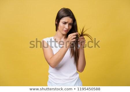 Pretty woman holding her long hair stock photo © imarin