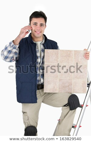Happy tiler on the phone Stock photo © photography33