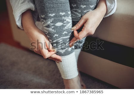 woman putting on black stockings stock photo © photography33
