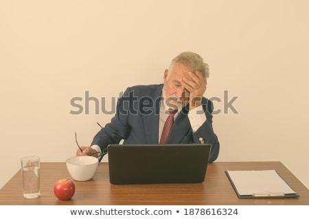 Imprenditore mal di testa bianco faccia sfondo lavoratore Foto d'archivio © wavebreak_media