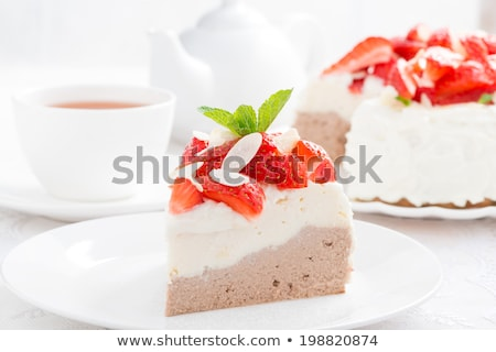 Whipped cream cake garnished with fruit pieces Stock photo © icefront