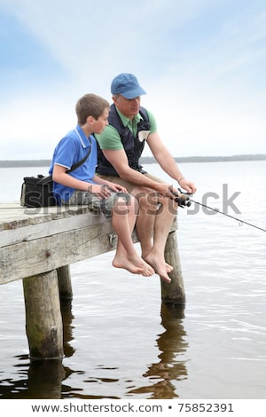 father and son on a pontoon Stock photo © photography33
