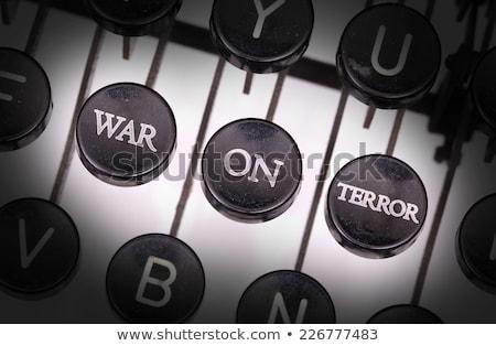 terror on old typewriters keys stock photo © tashatuvango