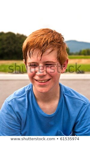 young happy boy sweating and exhausted from sports Stock photo © meinzahn