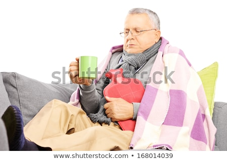 Senior man shivering in the cold isolated on white background Stock photo © bmonteny