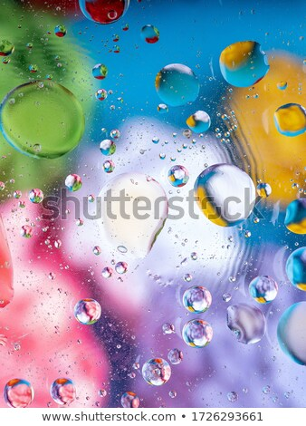 greenpink gradient oil drops in the water  abstract background stock photo © geribody