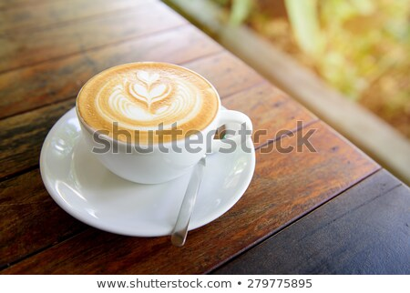 latte art design in mug stock photo © yanukit